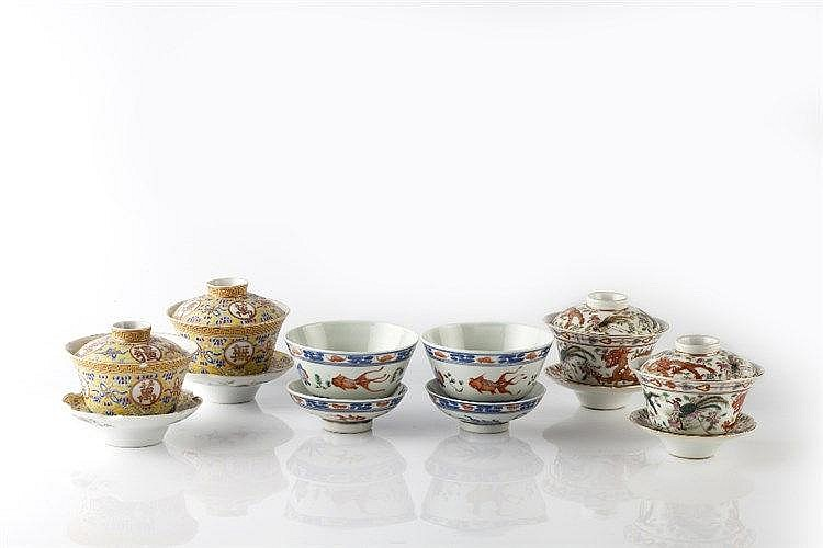 A Chinese pair of tea bowls, covers and stands 19th Century decorated