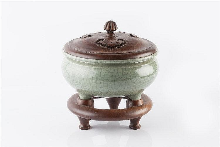 A Chinese crackled celadon glazed tripod censer late 19th Century