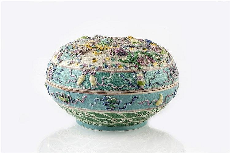 A Chinese porcelain covered bowl 19th Century with allover raised drag