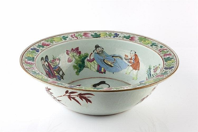 A Chinese Canton deep bowl 19th Century decorated in enamels with a gi