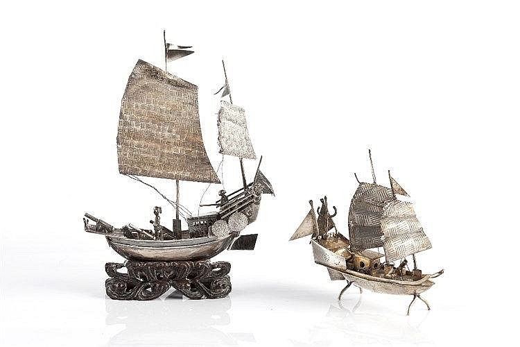 A Chinese silver junk with figures on the boats, marks for Wang Hing o