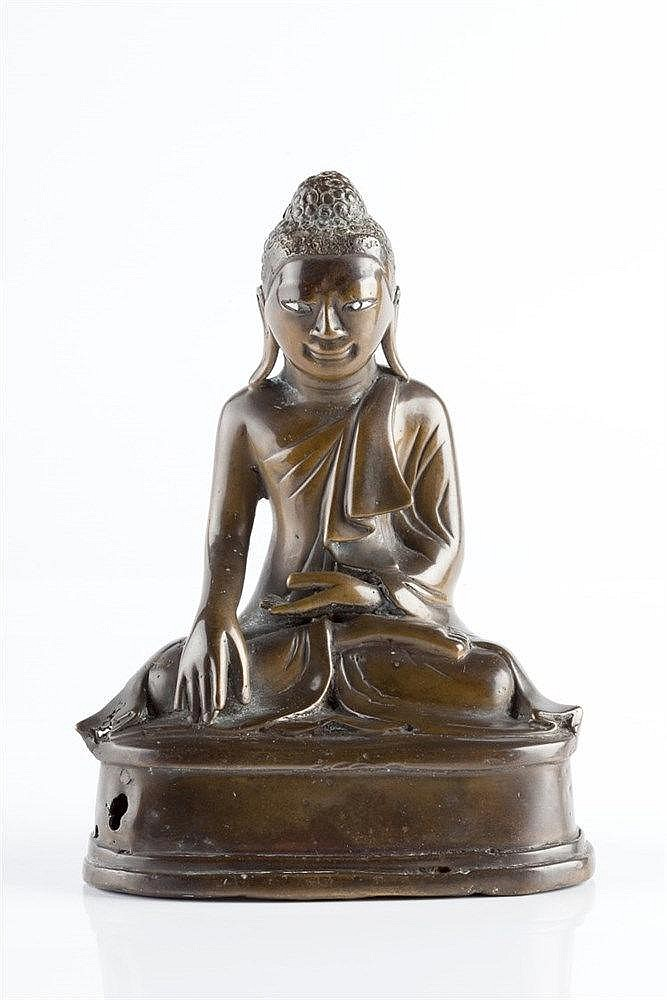 A Tibetan bronze seated Buddha 18th/19th Century the seated figure on