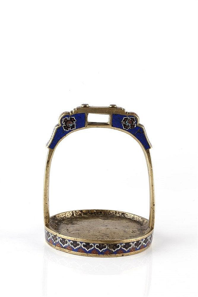 A Chinese cloisonne stirrup 19th Century and a Chinese copper heater o