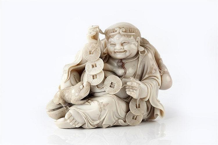 A Chinese soapstone carving of a smiling Sennin Gama  19th/20th Century