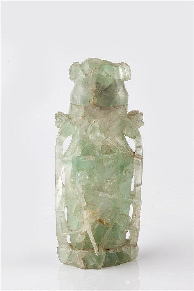 A Chinese fluorite vase and cover 19th Century carved with flower head