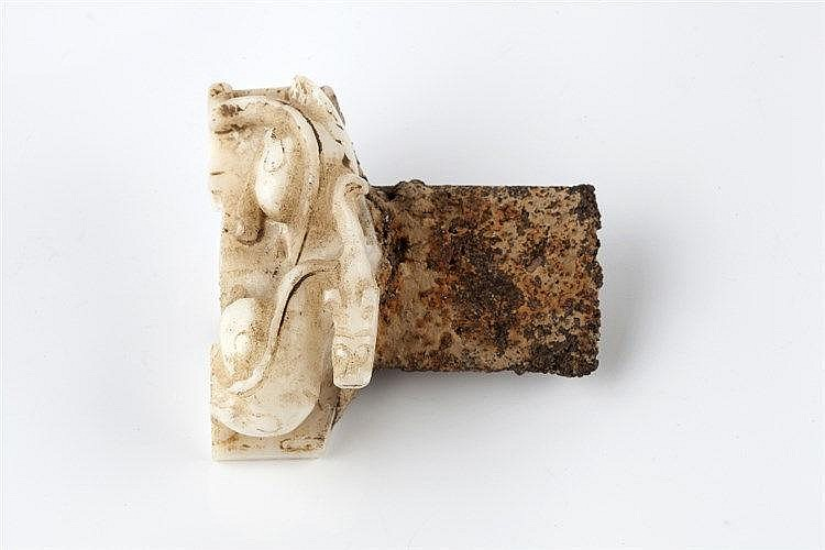 A Chinese white jade sword pommel Song dynasty carved in the form