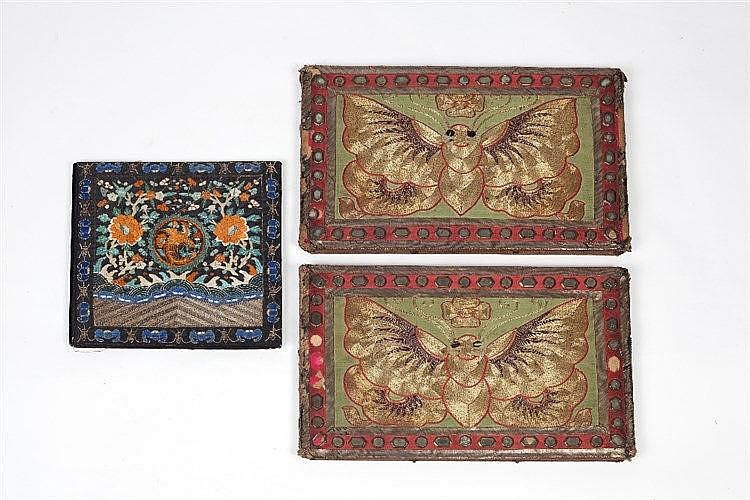A Chinese silk book cover embroidered with a central phoenix, the bord