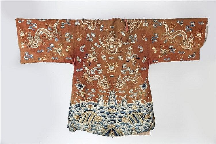 A Chinese coat 19th Century faded red felt with an embroidered central