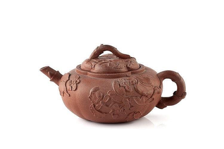 A Chinese Yixing teapot 19th Century of oval form with raised leaf and