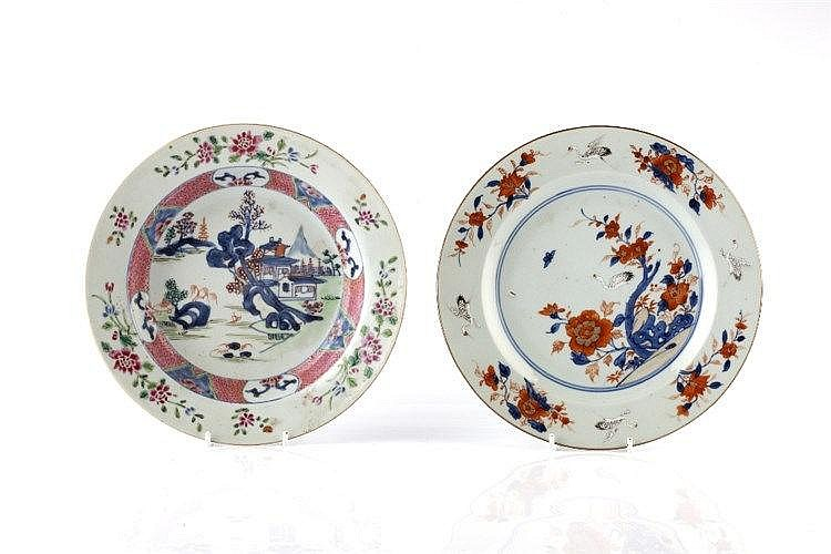 A Chinese famille rose plate 18th Century painted with storks around t