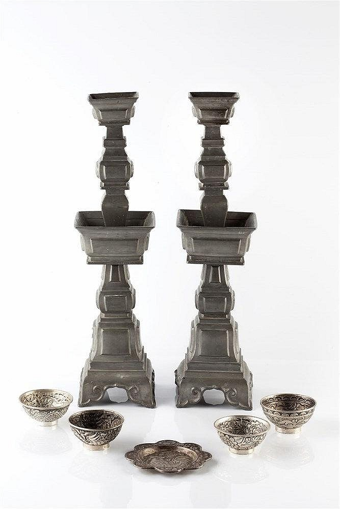 A pair of Chinese pewter stepped candlesticks circa 1900 made in