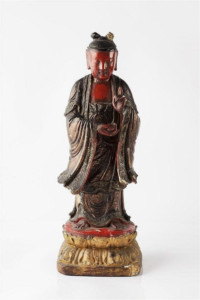 A Chinese wood and lacquer standing Buddha 17th Century the gilt and l