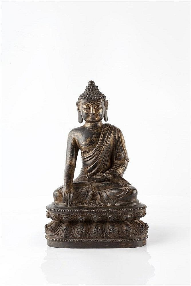 A gilt bronze figure of Buddha Ming Period (1368-1644) seated wit