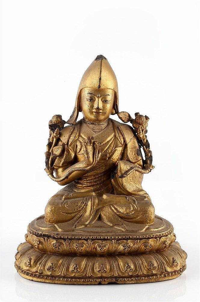 A Sino-Tibetan gilt Buddha 19th/20th Century the seated figure on a do