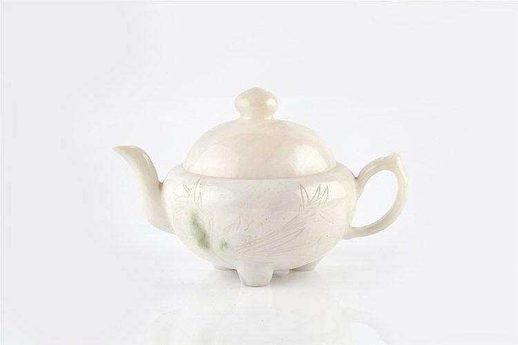 A Chinese white jade teapot and cover 19th Century the squat globular