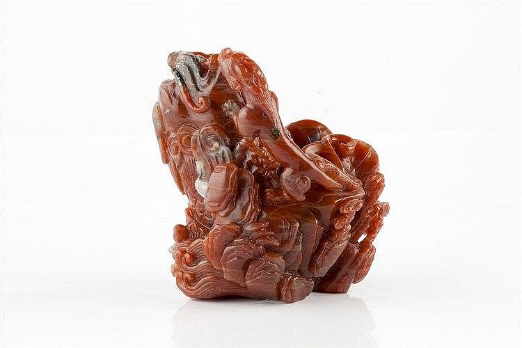A Chinese red agate boulder late 19th Century with grey green and