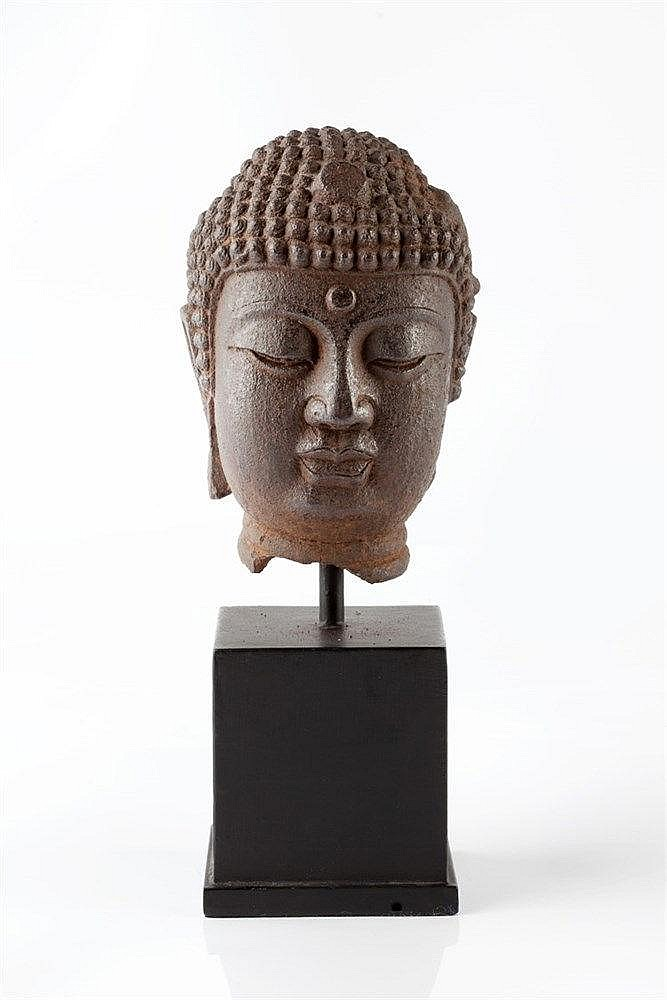 A Chinese iron head of Buddha Yuan/Ming dynasty mounted on a wood