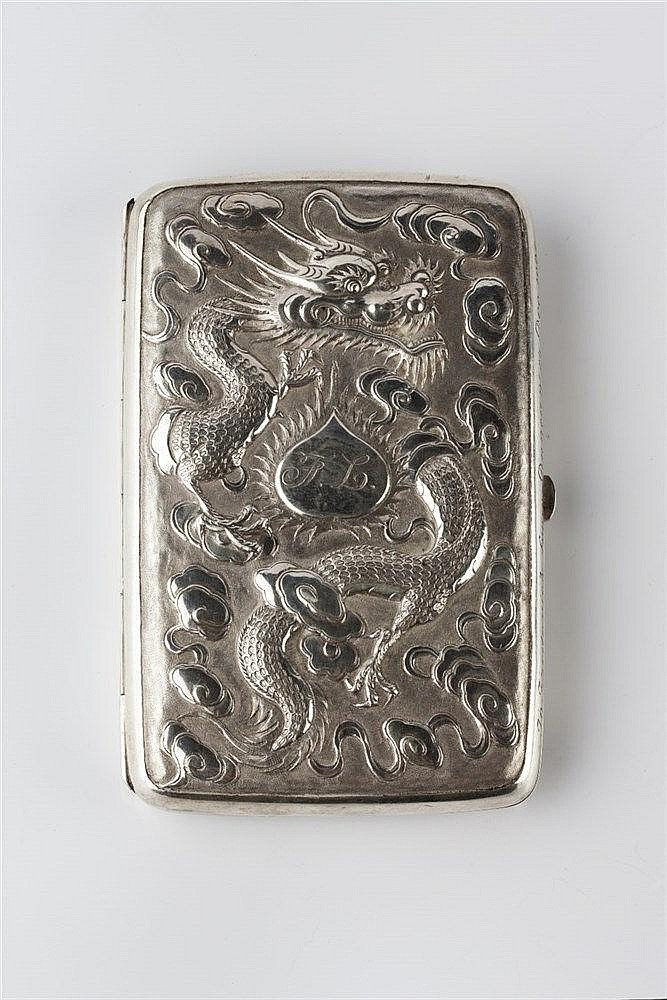 A Chinese silver folding cigar case with embossed dragon and clouds to