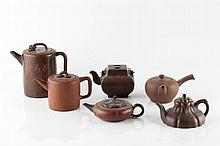 A collection of six Yixing teapots 19th/20th Century including a cylin