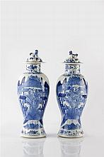 A pair of Chinese blue and white baluster vases and covers 19th Century
