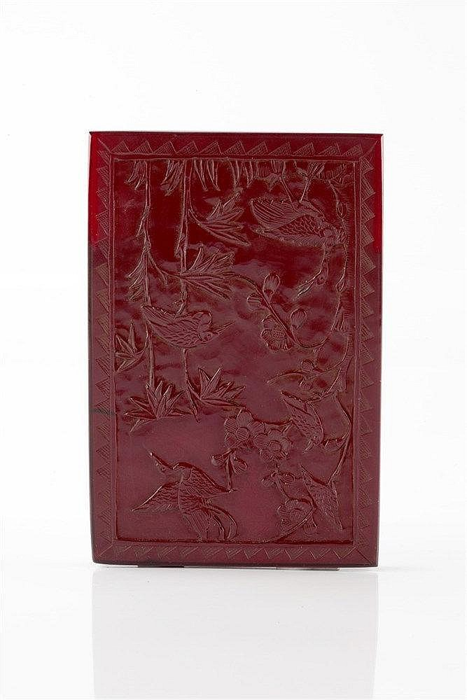 A Chinese amber panel 19th Century carved with a crane, other bi