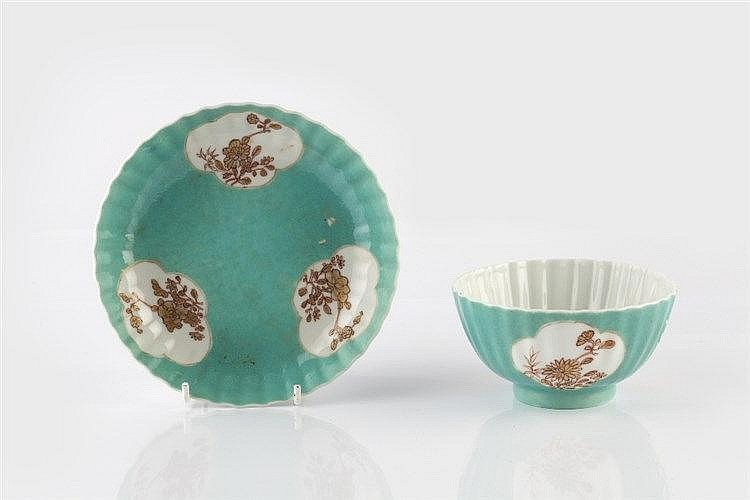 A Chinese turquoise ground cup and saucer 19th Century decorated in th