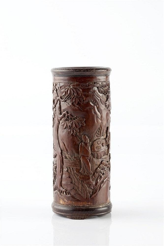 A Chinese bamboo brush pot (bidong) 18th/19th Century carved in low re