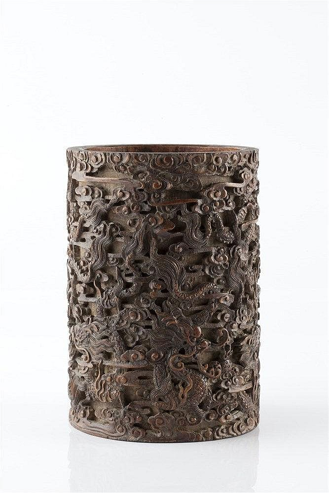 A Chinese bamboo brush pot (bidong) 19th Century carved and undercut w
