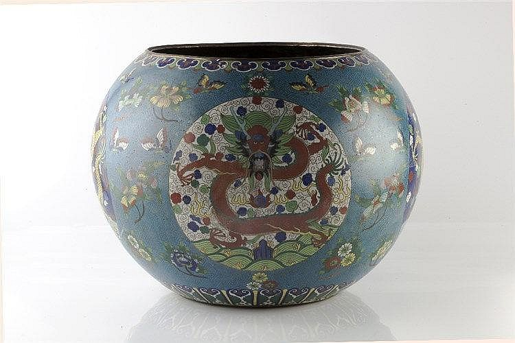 A large Chinese jardiniere 19th Century having panels of dragons on a