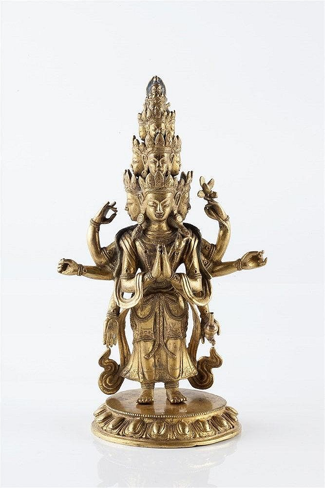A Tibetan gilt bronze eleven headed six armed Avalokitesvara 18th/19th Cent