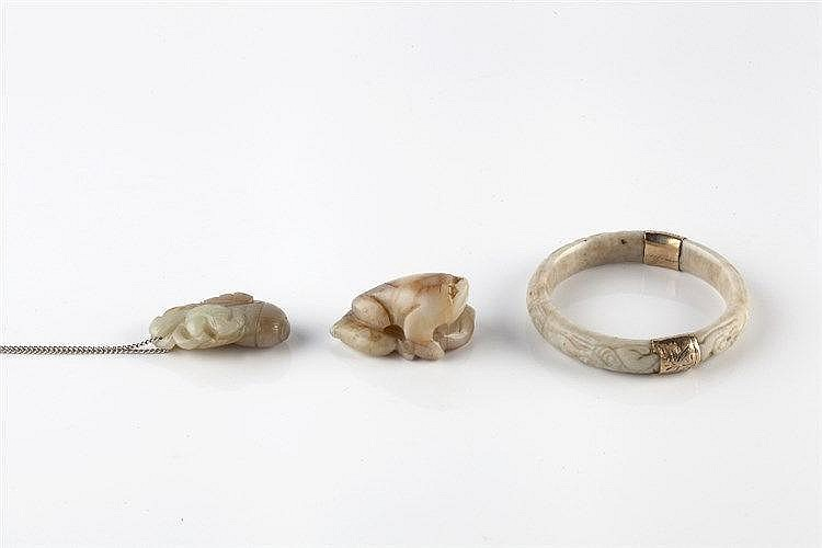 A Chinese jade bangle 19th Century carved with phoenix and dragon, rep