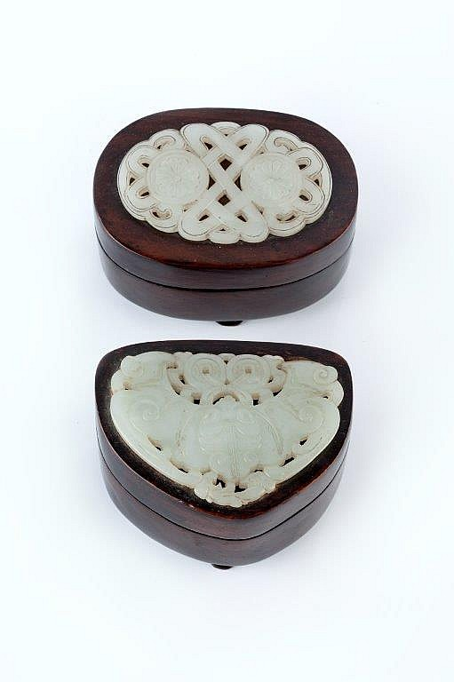 A Chinese huanghuali wood box of oval form 19th Century the cover over