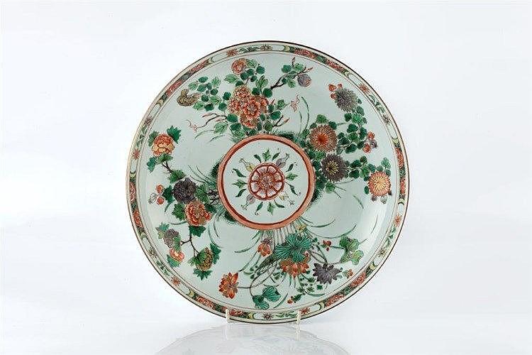 A Chinese famille verte shallow circular dish Kangxi having a cen