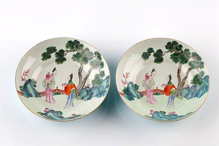 A pair of Chinese famille rose saucer dishes 19th Century decorated wi