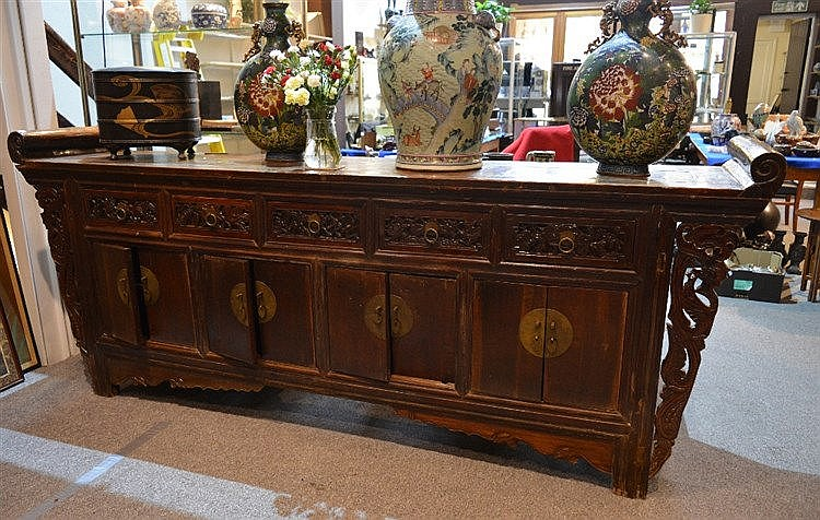 A Chinese elm large side cabinet 19th Century with fitted drawers and