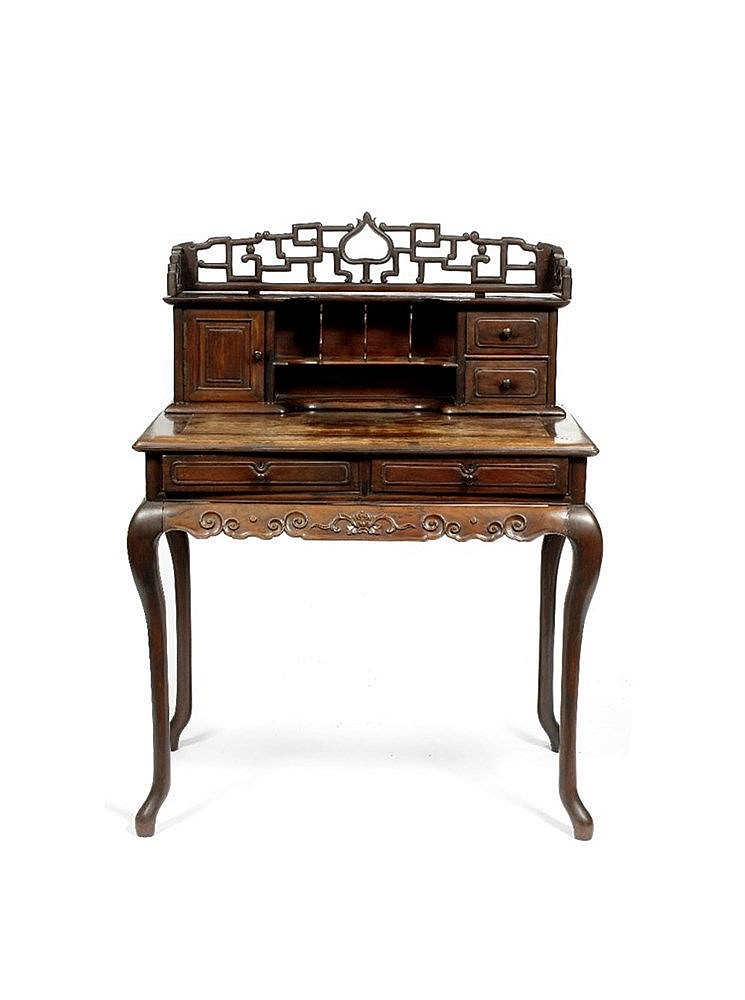 A Chinese hardwood writing desk 19th Century having a raised gallery b