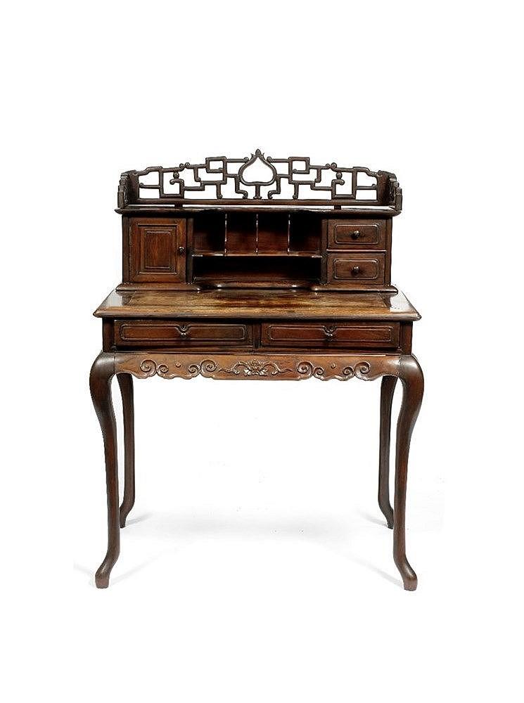 A Chinese hardwood writing desk 19th Century having a raised gallery b