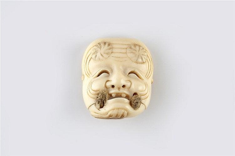 An ivory netsuke mask of Okina Edo/Meiji period signed Hakuunsai,