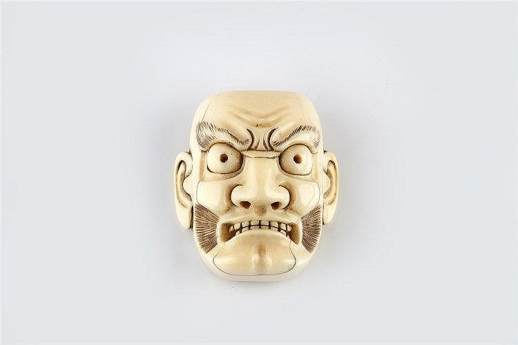 An ivory netsuke mask probably of Kentoku mid 19th Century signed