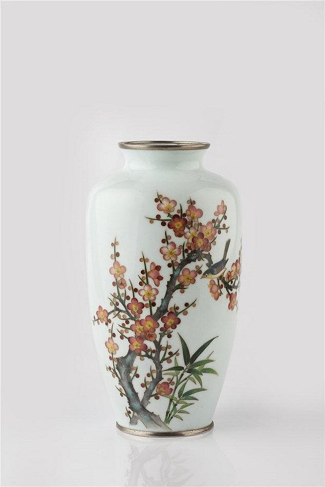 A Japanese cloisonne enamel vase Meiji period with a bird perched