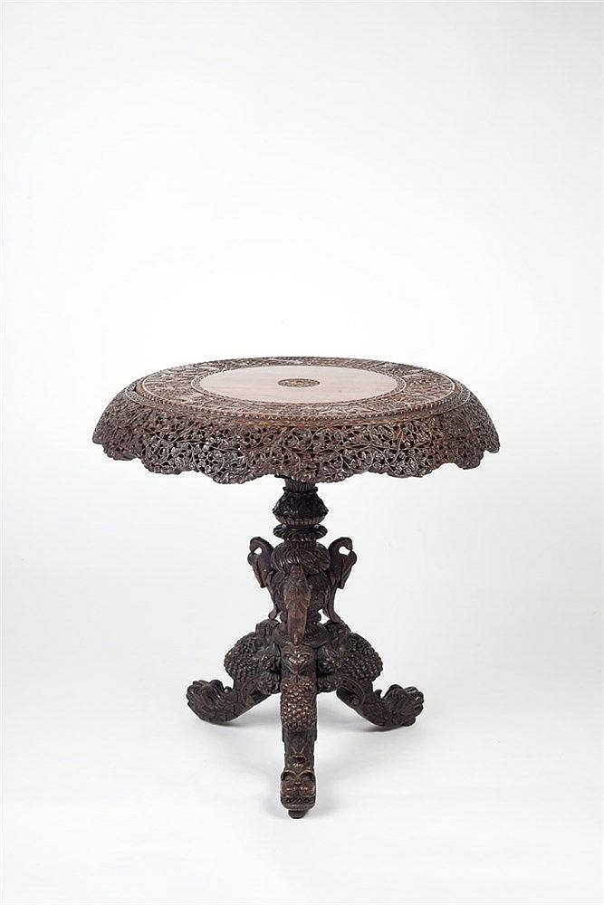 A hardwood carved Burmese tripod table 19th century  the top decorated