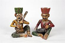 A pair of carved Indian wooden figures 19th century Rajsthain, a sitar