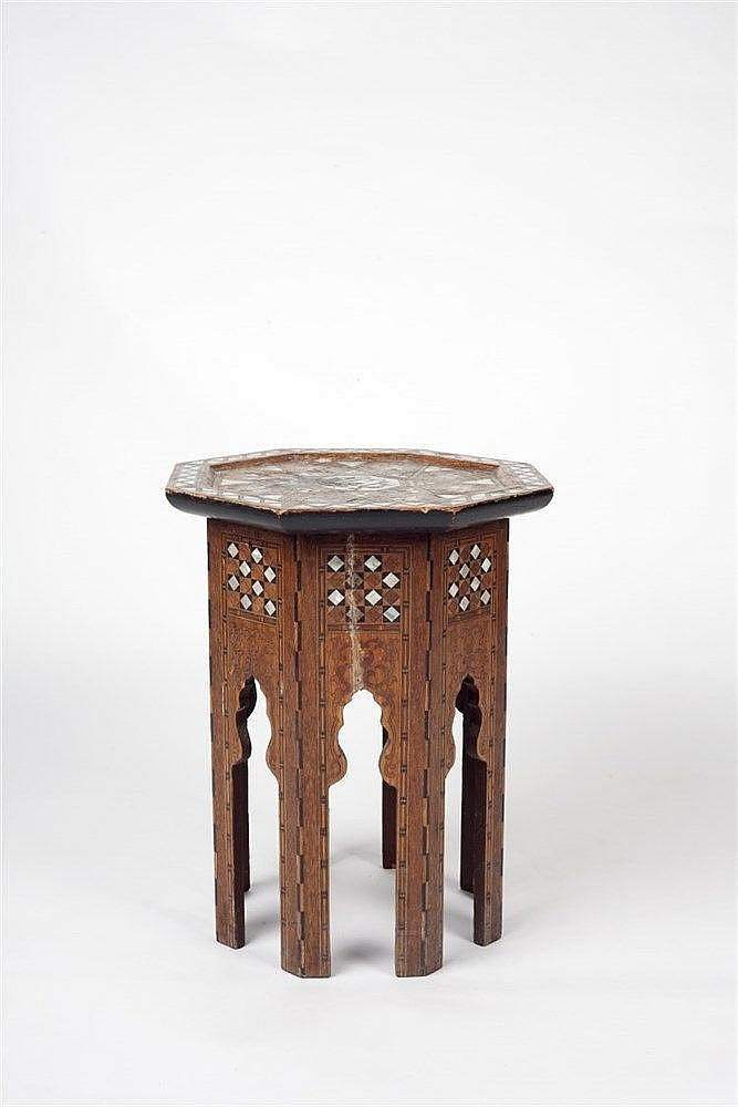 An octagonal inlaid Islamic table 19th century with mother of pearl an