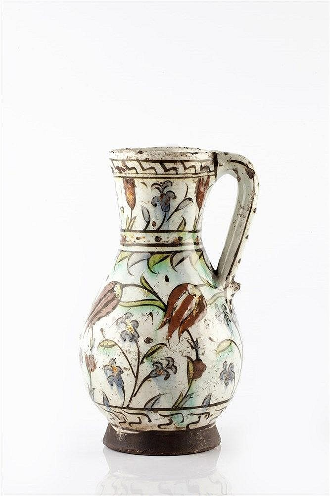 An Iznik glazed pottery jug circa 1575 painted with red impasto t