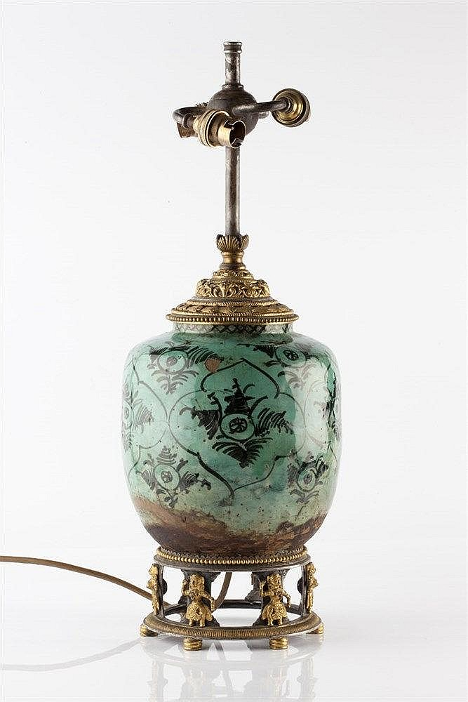 A Persian turquoise vase 19th Century with gilt metal mounts, 33cm hig