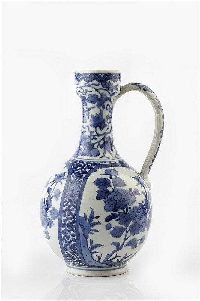 A Japanese blue and white Arita porcelain ewer 17th Century with long