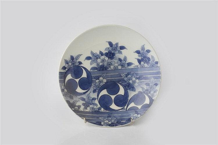 A Japanese Nabeshima blue and white dish 19th Century decorated with t