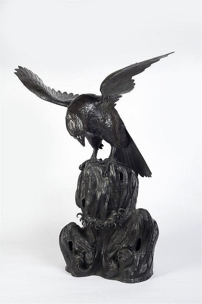 A bronze okimono of a hawk Meiji period in shakudo and gilt, perc