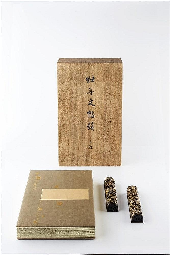 A Japanese bamboo case containing a pair of bronze and gilt metal pape