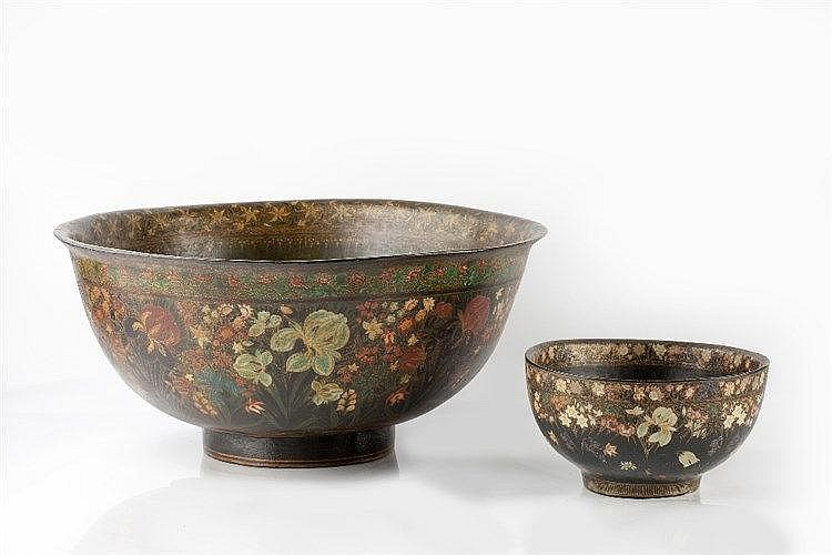 Two Indian papier mache bowls each with hand painted flowers and gilt